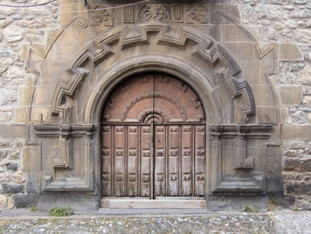 Old church door in Potes, Cantabria (Spain)