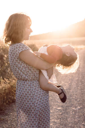 Portrait of happy mother and daughter in the country Stock Photo