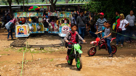 Ponorogo, Indonesia- 01012020: A boy is riding a toy trail motorbike. Education to test motor nerves and driving ability