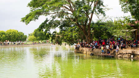 Ponorogo, Indonesia-01012020: The crowd was on the edge of the lake enjoying the beauty of the lake on holidays