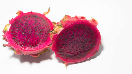 Dragon fruit slices with blushed red flesh. Dragon fruit contains 70% water and vitamins, suitable for use as a diet menu