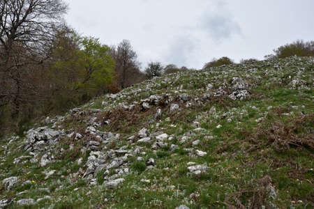 awakening: Walk through the mountains, the freshness of spring, awakening of nature, mountain landscapes, mountain lakes, Italian landscapes.