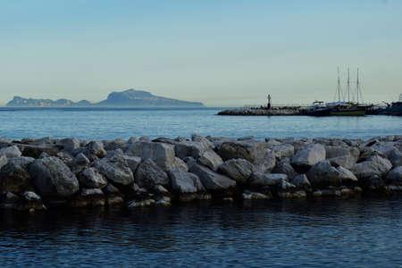 tyrrhenian: Walk along the promenade , Capri at sunset, calm sea, the sunset on the Tyrrhenian Sea, Italian landscapes, Bay of Naples in the evening.