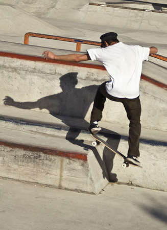 shadow: Skateboarder jumping in a skateboard park Stock Photo