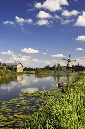 Windmill in the distance, Holland Stock Photo