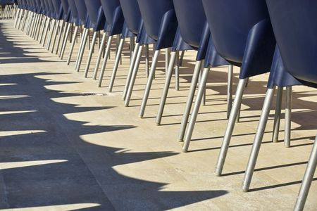 Row of blue chairs from behind in a holiday resort, Turkey photo