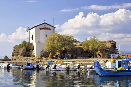 Chapel built on rocks in the port of Skala Sykamineas on Lesbos, Greece