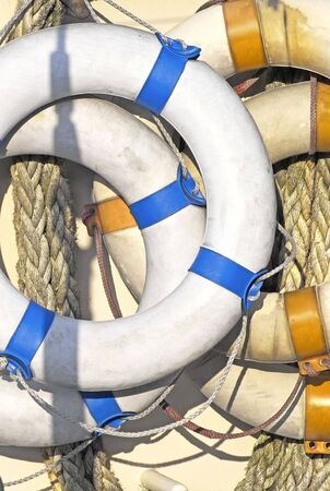 Life-belts hanging on the side of a ship
