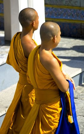 Two monks strolling in the grounds of the Grand Palace in Bangkok