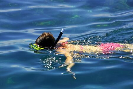 A woman snorkeling in the sea