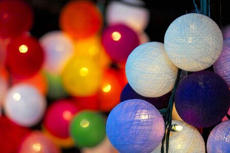 Close-up of multicoloured Christmas lights in the shape of a ball