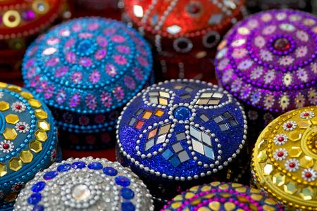 Multicoloured round jewellery caskets in a row photo