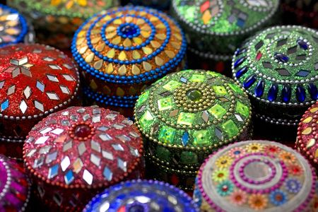 Close-up of multicoloured jewellery boxes in a row photo