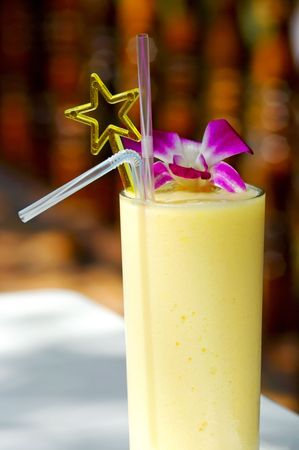 A tropical decorated banana and pineapple smoothie photo