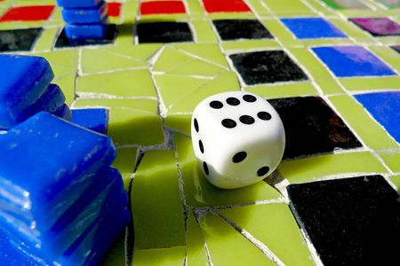 A close-up of a mosaic table with chips and dice photo