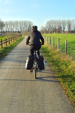Woman cycling on a trekking bike in the winter Stock Photo - 6123769