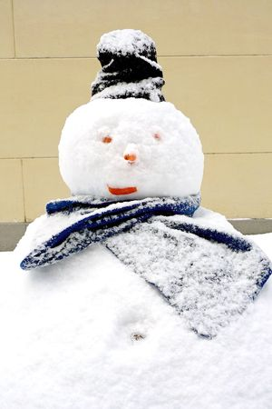 A fat snowman with a black hat photo