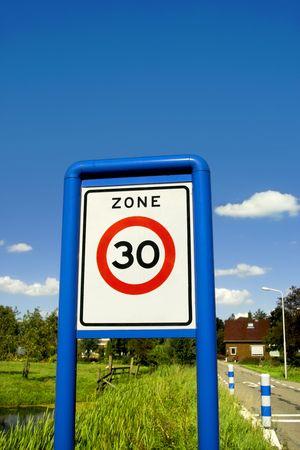 Road sign close-up, speed limit zone Standard-Bild