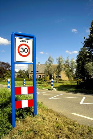 Road sign, speed limit zone Stock Photo