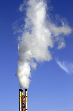 incinerator: Chimney from a refuse incinerator emitting smoke Stock Photo