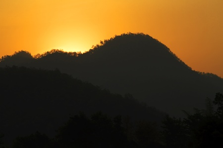 Sunrise high in the mountains in the jungle of Northern Thailand