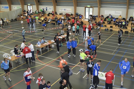 DORDRECHT, THE NETHERLANDS - APRIL 3 2011: runners gathering in the hall for the start of 'Dwars door Dort' 10km race.