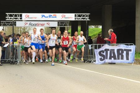 dordrecht: DORDRECHT, THE NETHERLANDS - APRIL 3 2011: runners at the start Dwars door Dort 10km race.