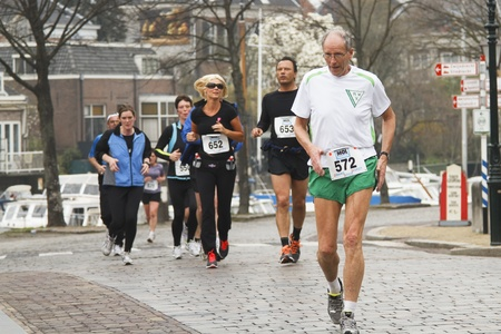 DORDRECHT, THE NETHERLANDS - APRIL 3 2011: runners in Dwars door Dort 10km race for all ages.