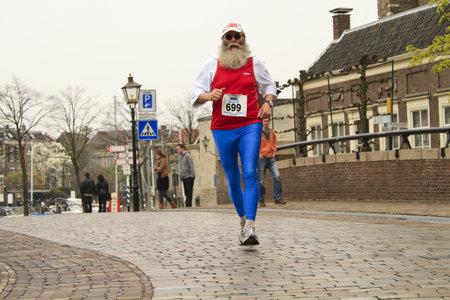 DORDRECHT, THE NETHERLANDS - APRIL 3 2011: runner in 'Dwars door Dort' 10km race for all ages.