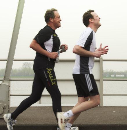 fast foot: DORDRECHT, THE NETHERLANDS - APRIL 3 2011: runners feeling the pain in the Dwars door Dort 10km race.