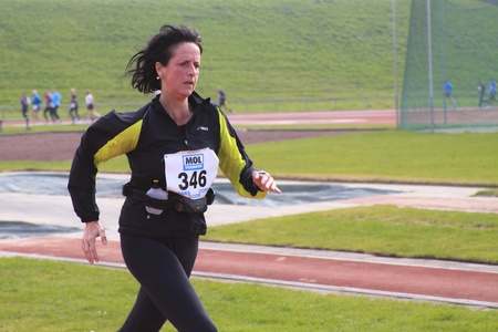 DORDRECHT, THE NETHERLANDS - APRIL 3 2011: female runner near the end of 'Dwars door Dort' 10km race.