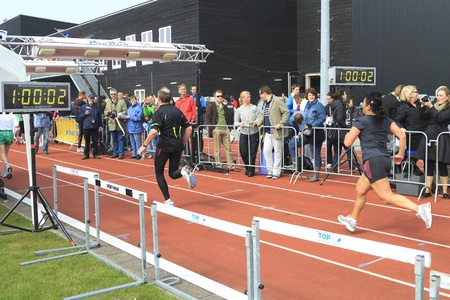 DORDRECHT, THE NETHERLANDS - APRIL 3 2011: runners crossing the line at the end of 'Dwars door Dort' 10km race.