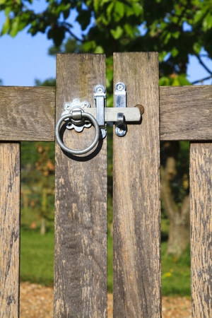 Latched wooden gate in rural England on a sunny day Stock Photo