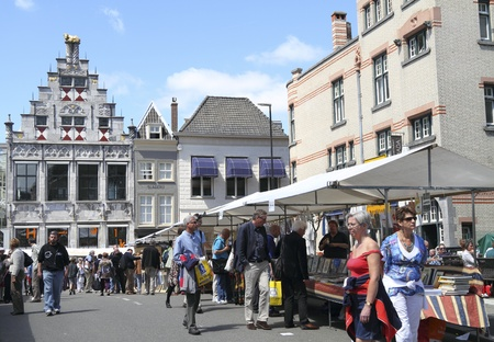 DORDRECHT, THE NETHERLANDS - JULY 3: People searching for books on the book market Sunday July 3, 2011 in Dordrecht. This famous book market is held every year in the city center of Dordrecht Editorial