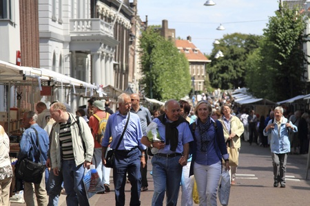 DORDRECHT, THE NETHERLANDS - JULY 3: People visiting the second hand book market Sunday July 3, 2011 in Dordrecht. This famous book market and fair is held every year in the city center of Dordrecht Stock Photo - 9891311