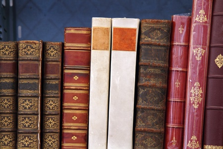 Antiquarian books standing on a shelf photo