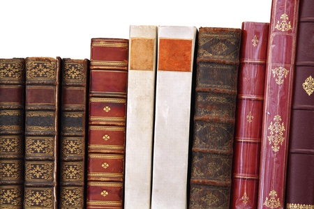 A row of isolated old books standing in a row Stock Photo - 10525125