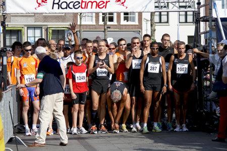 DORDRECHT, NETHERLANDS - SEPTEMBER 25 2011: Runners line up for the start of the 6th Drechtstedenloop in Dordrecht on September 25, 2011. The race is a 10km and 5km street circuit for all ages.