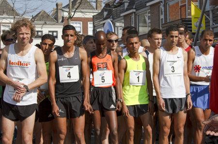 DORDRECHT, NETHERLANDS - SEPTEMBER 25 2011: Top runners line up for the 6th Drechtstedenloop in Dordrecht on September 25, 2011. The half marathon is a street circuit with international ambitions.