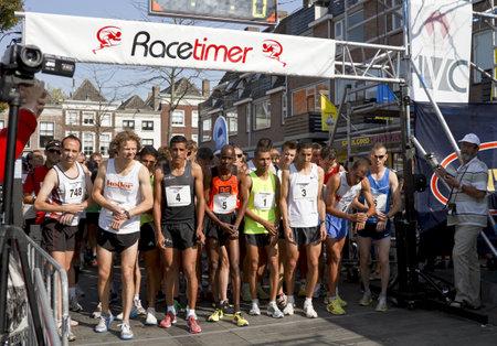 DORDRECHT, NETHERLANDS - SEPTEMBER 25 2011: Top runners line up for the 6th Drechtstedenloop in Dordrecht on September 25, 2011. The half marathon is a street circuit running through the old city.