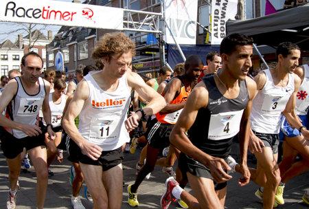 DORDRECHT, NETHERLANDS - SEPTEMBER 25 2011: Runners begin the 6th Drechtstedenloop in Dordrecht on September 25, 2011. The half marathon is a street circuit running through the old city.