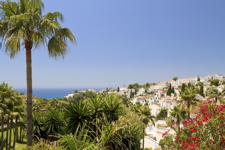 View over white holiday villas in Nerja out to the sea
