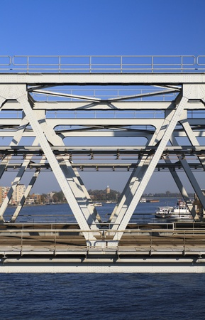View through a railway bridge along the river Maas in Holland Stock Photo