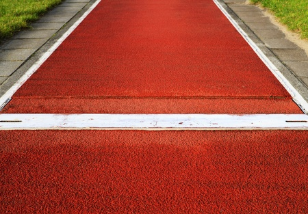 Long jump spring plank in an outdoor sports and athletic stadium