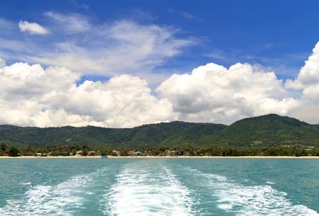 Wake of a ship leaving the coast of Samui island Thailand Stock Photo
