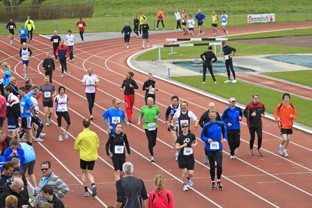 DORDRECHT, NETHERLANDS - APRIL 1 2012: The 65th editing ÔDwars door DortÕ on Sunday 1 April 2012. Runners warming up on the track at the sports stadium