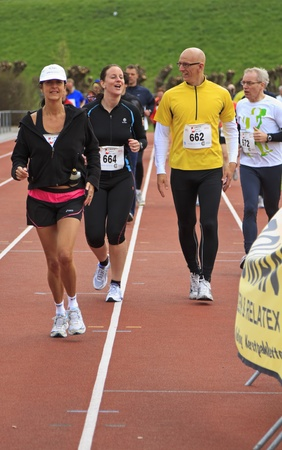 DORDRECHT, NETHERLANDS - APRIL 1 2012: The 65th edition ÔDwars door DortÕ on Sunday 1 April 2012. Male and female runners warming up on the track before the race