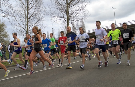 DORDRECHT, NETHERLANDS - APRIL 1 2012: The 65th edition �Dwars door Dort� on Sunday 1 April 2012. Runners race off fast at the start of the race