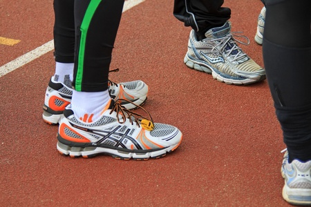 DORDRECHT, NETHERLANDS - APRIL 1 2012: The 65th edition �Dwars door Dort� on Sunday 1 April 2012. Runners standing in a group on the track before the race