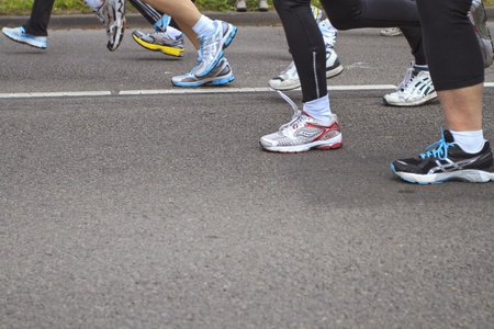 DORDRECHT, NETHERLANDS - APRIL 1 2012: The 65th edition �Dwars door Dort� on Sunday 1 April 2012. Detail of the legs of runners in the 10km race in Dordrecht Editorial